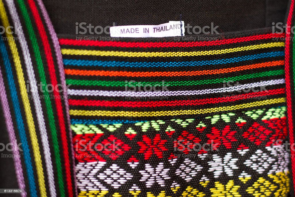 Traditional Thai Cotton Textile/Dress Detail (Close-Up), 'Made in Thailand' tag stock photo