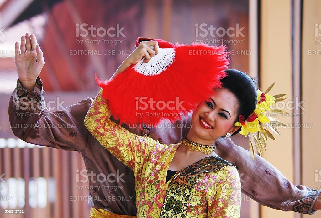 Traditional Thai dancers with hand  fan stock photo