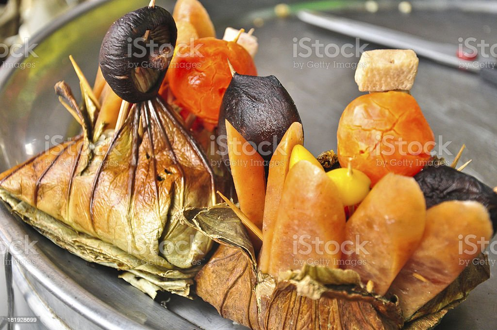 Traditional Thai food rice wrapped in lotus leaves for sale stock photo