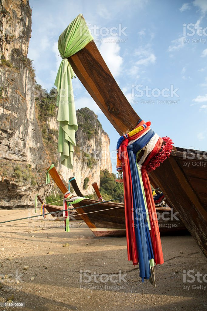 Traditional Thai Longtail Fishing Boats Prows Moored on the Beach stock photo
