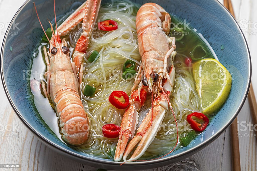 Traditional Thai soup with scampi and noodles royalty-free stock photo