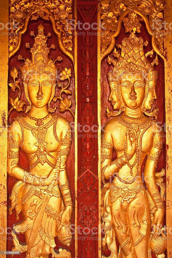 Traditional Thai style door of Buddhist church stock photo
