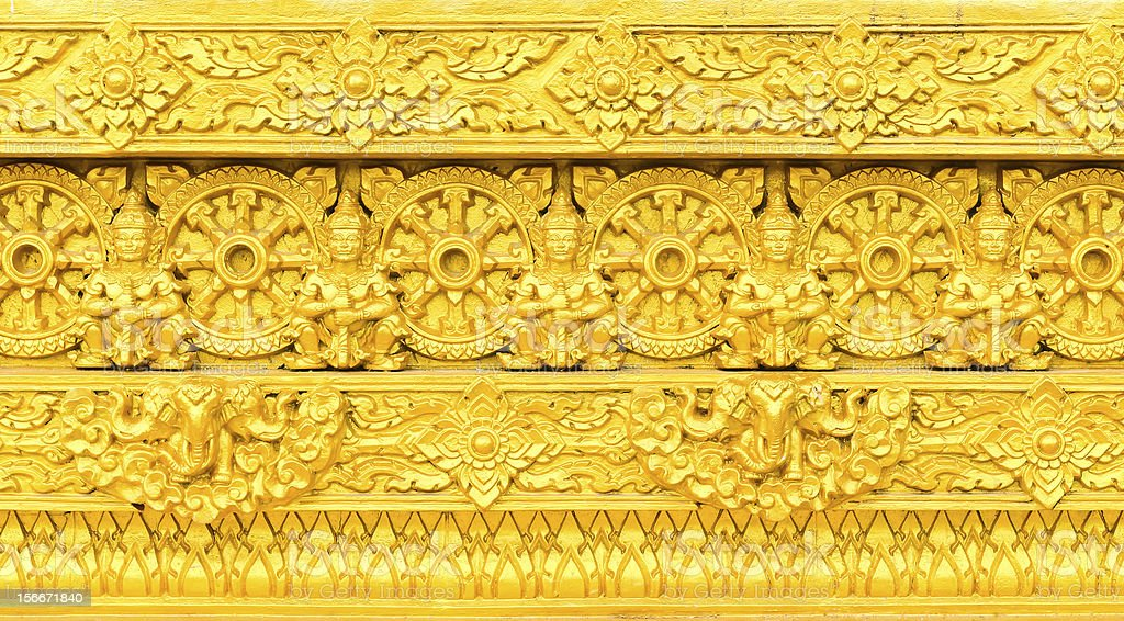 Traditional Thai style sculpture on the wall royalty-free stock photo