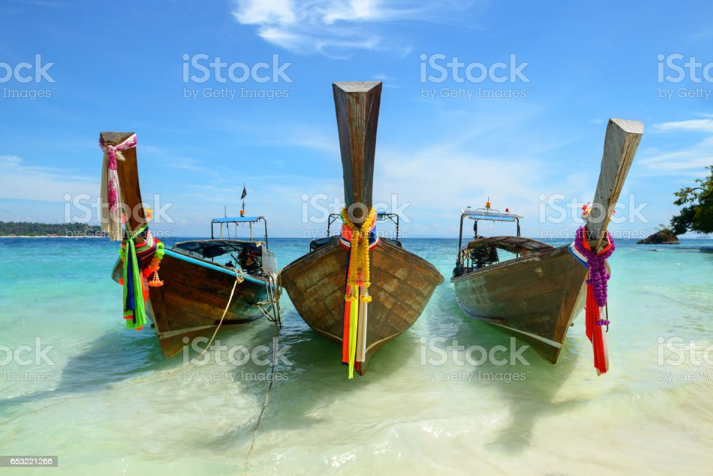 Traditional thai three boat on the beach of Phi Phi island in Thailand stock photo