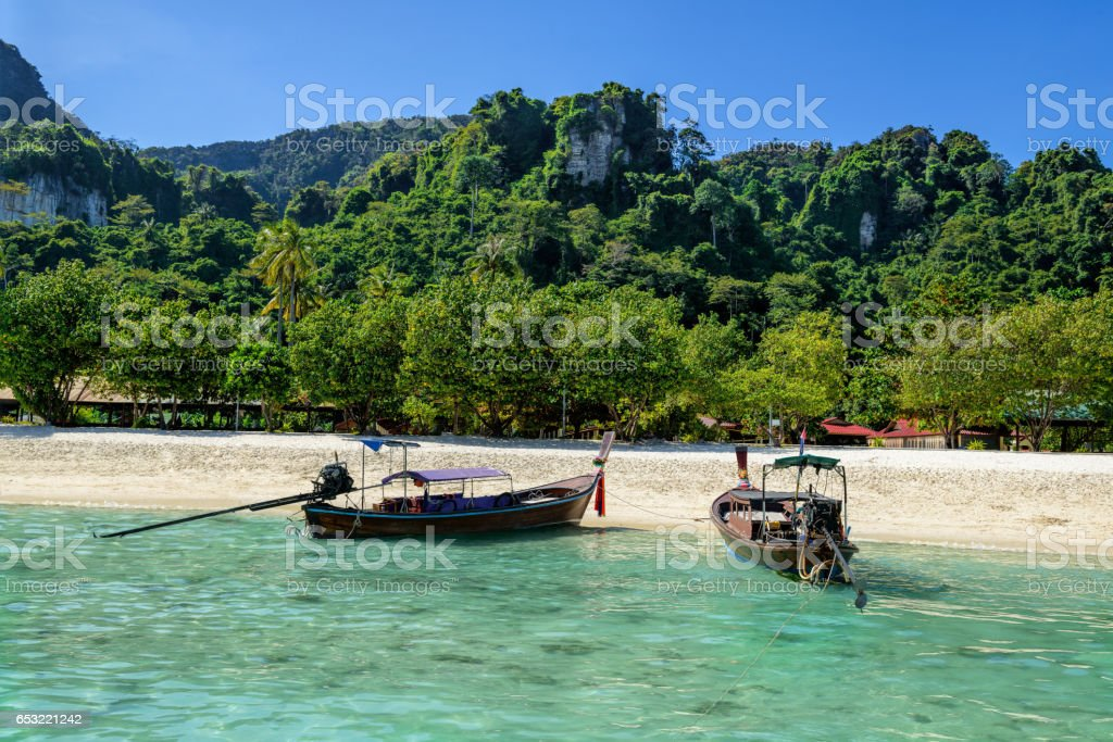Traditional Thai two boat on the beach of Phi Phi island in Thailand stock photo