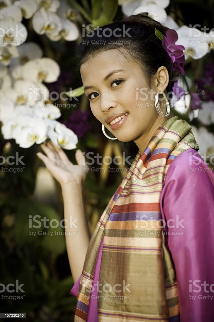 Traditional Thai Woman with Orchids royalty-free stock photo