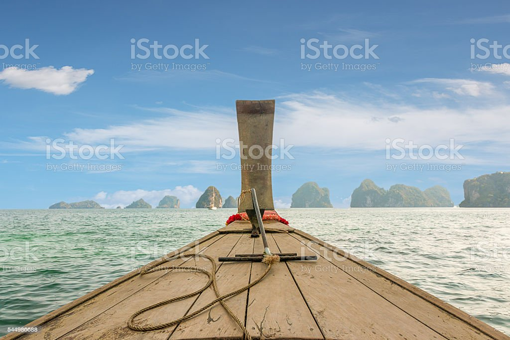 Traditional Thai wooden longtail boat heads. stock photo