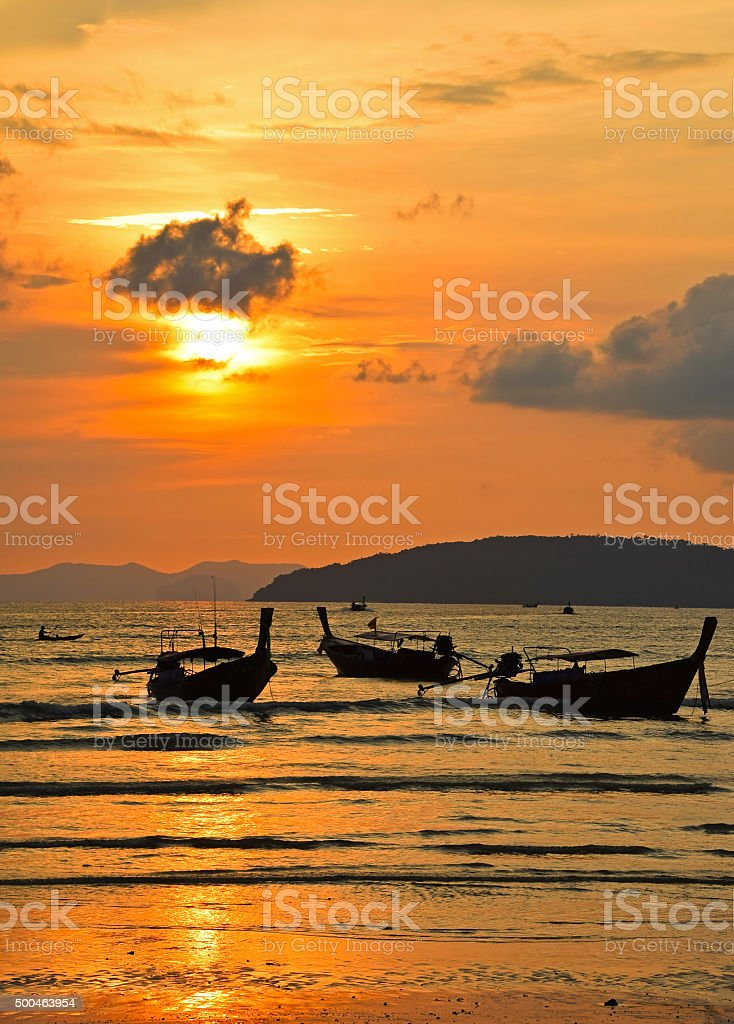 Traditional Thailand long tail boats at sunset royalty-free stock photo