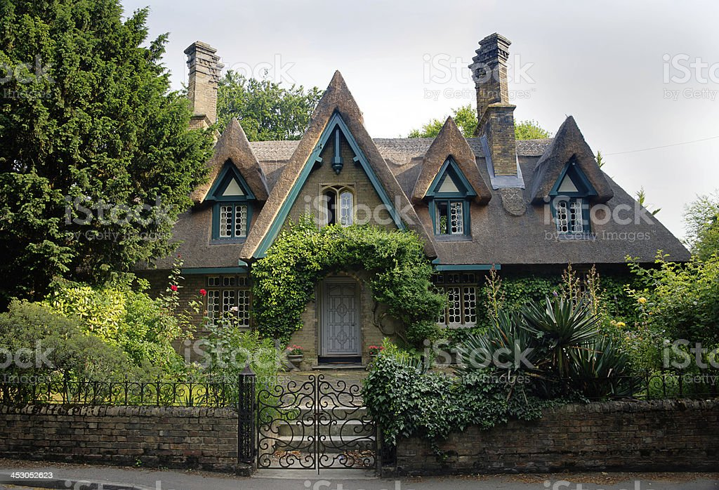 Traditional Thatched Roof Cottage in English countryside royalty-free stock photo