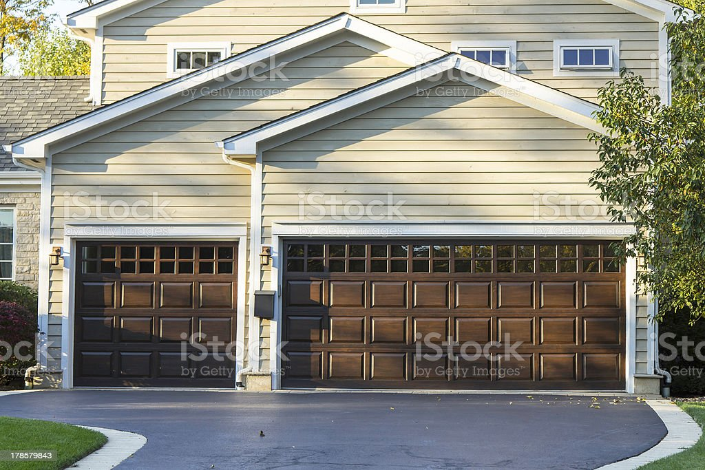 Traditional three car wooden garage royalty-free stock photo
