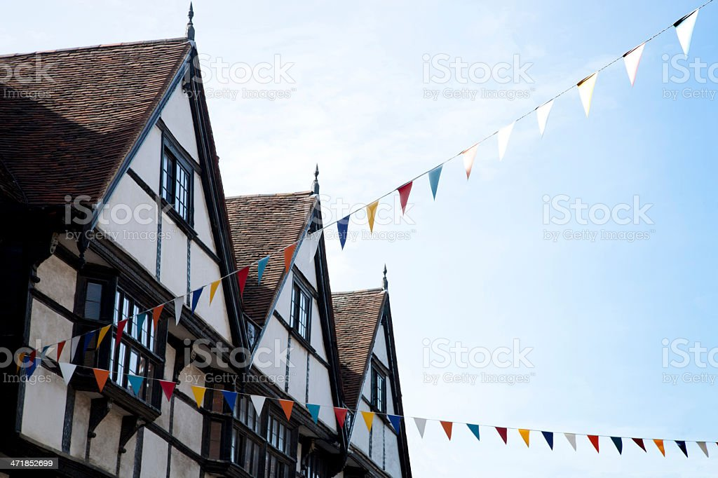 Traditional Tudor houses with bunting royalty-free stock photo