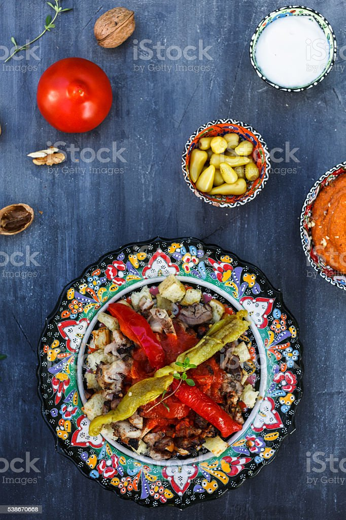 Traditional Turkish Bursa iskender kebap doner served with red sauce stock photo