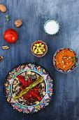 Traditional Turkish Bursa iskender kebap doner served with red sauce