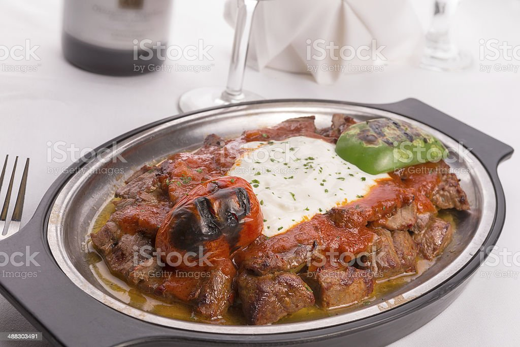 Traditional Turkish Bursa Iskender Kebap with Grilled Vegies stock photo