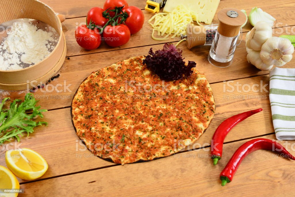 Traditional Turkish food lahmacun and wood background stock photo
