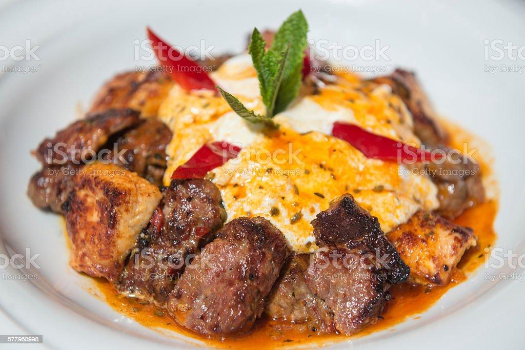 Traditional Turkish Iskender kebap served with tomato sauce and yogurt stock photo
