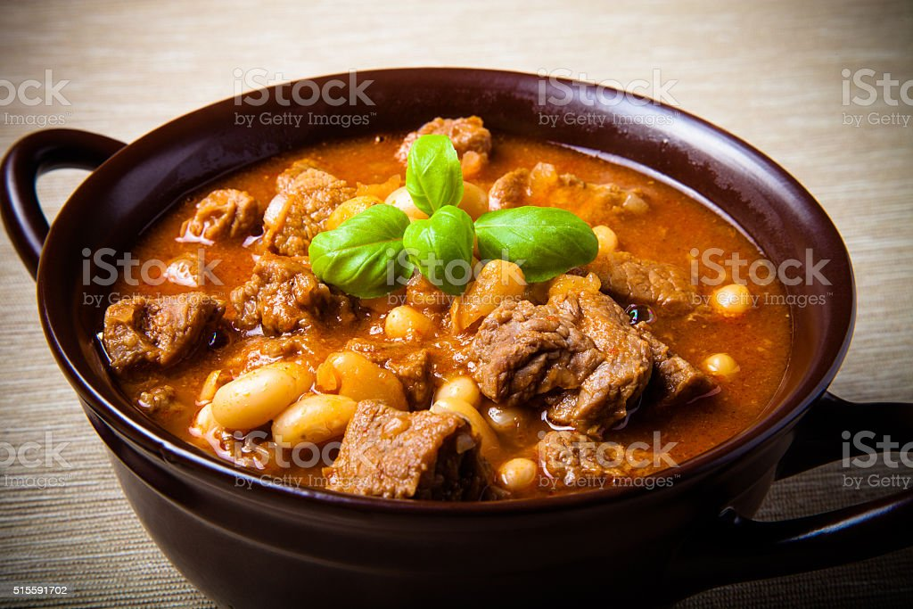 Traditional turkish meal - Kuru fasulye in a clay bowl stock photo