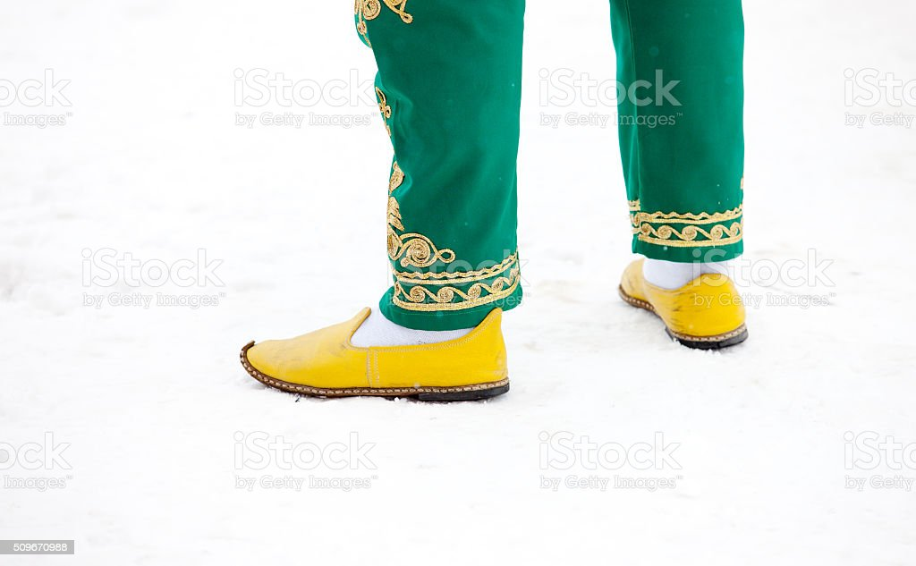 Traditional Turkish pants and shoes stock photo