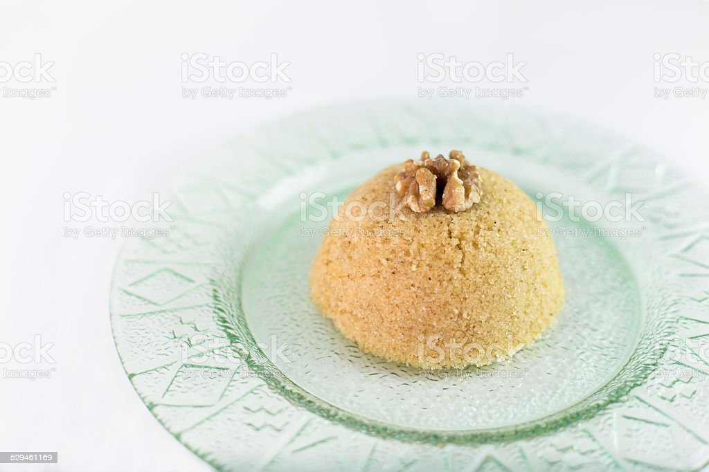Traditional Turkish semolina sweet desert halva (irmik helvasi) with nuts stock photo