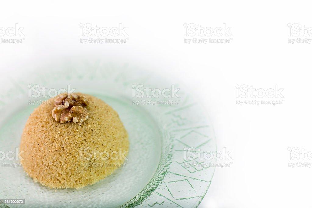 Traditional Turkish semolina sweet desert halva with nuts stock photo