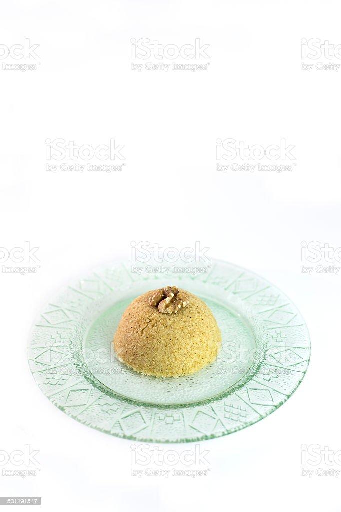 Traditional Turkish semolina sweet desert halva-irmik helvasi with nuts stock photo