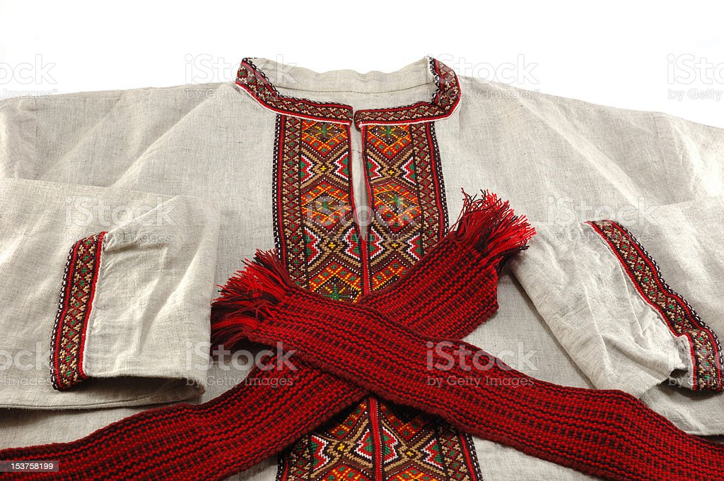 Traditional ukrainian clothes - embroidered shirt and red sash stock photo