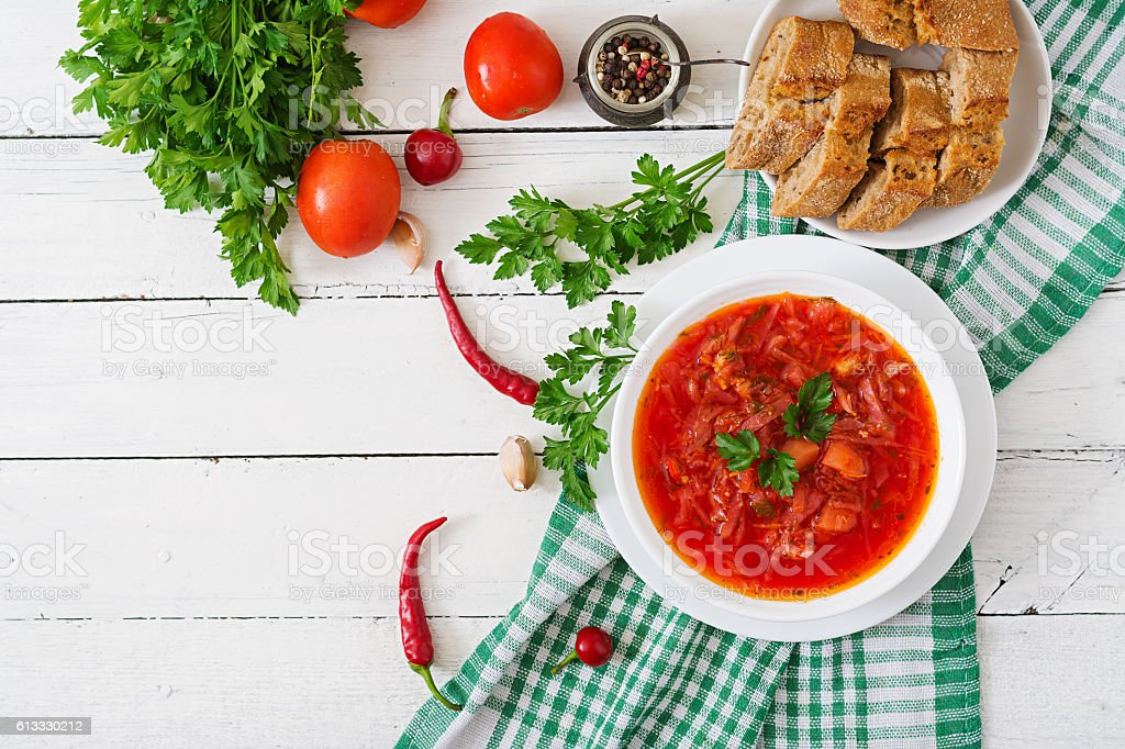 Traditional Ukrainian Russian vegetable borscht on the white wooden background stock photo