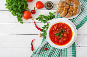 Traditional Ukrainian Russian vegetable borscht on the white wooden background