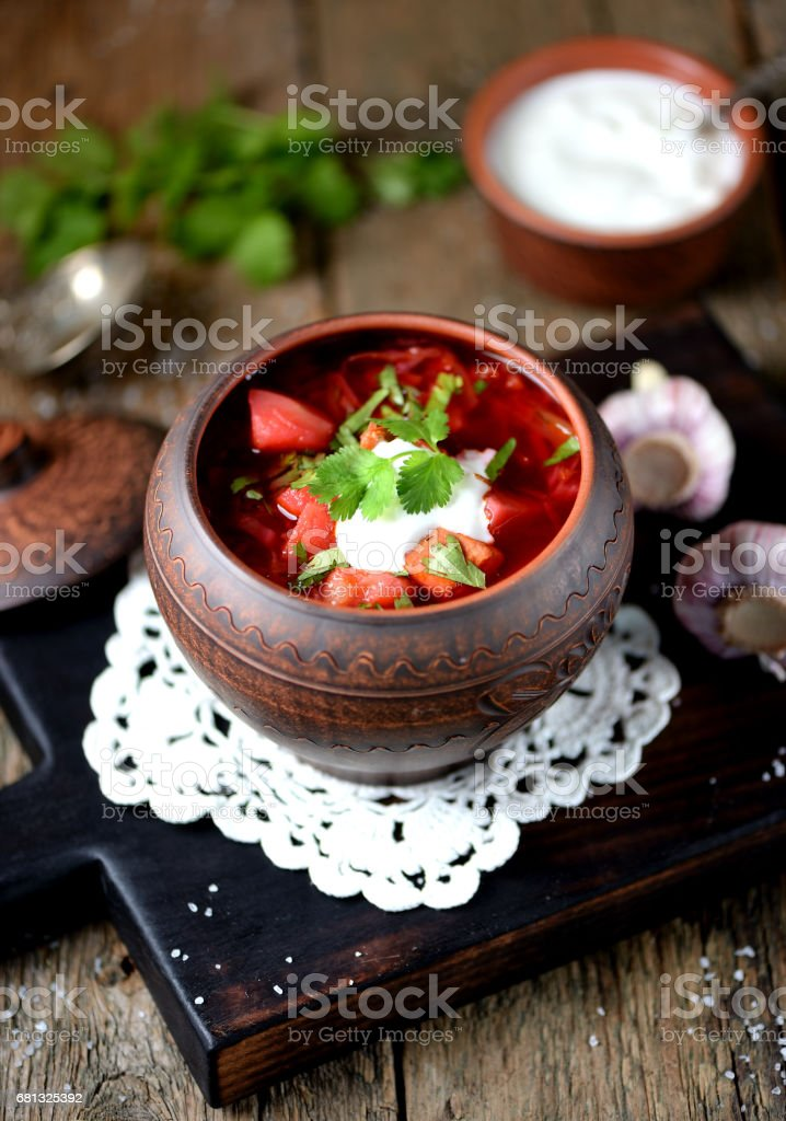 Traditional Ukrainian soup borscht on an old wooden background. Rustic style. stock photo