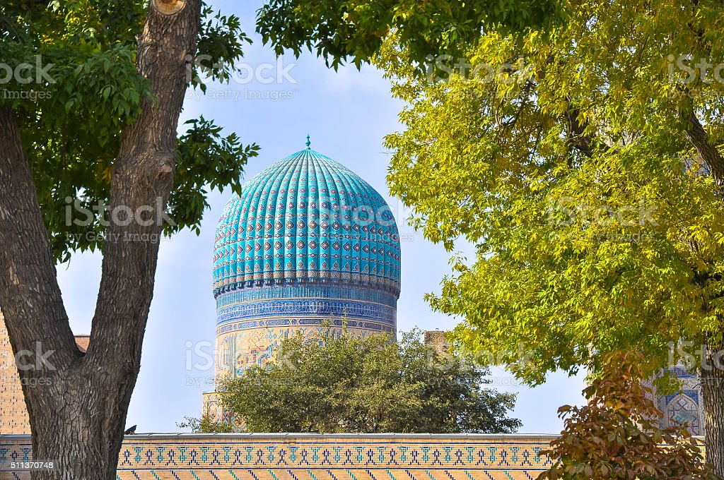 Traditional uzbek dome framed by autumn trees stock photo