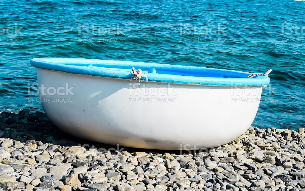 Traditional Vietnamese boats on the beach. stock photo