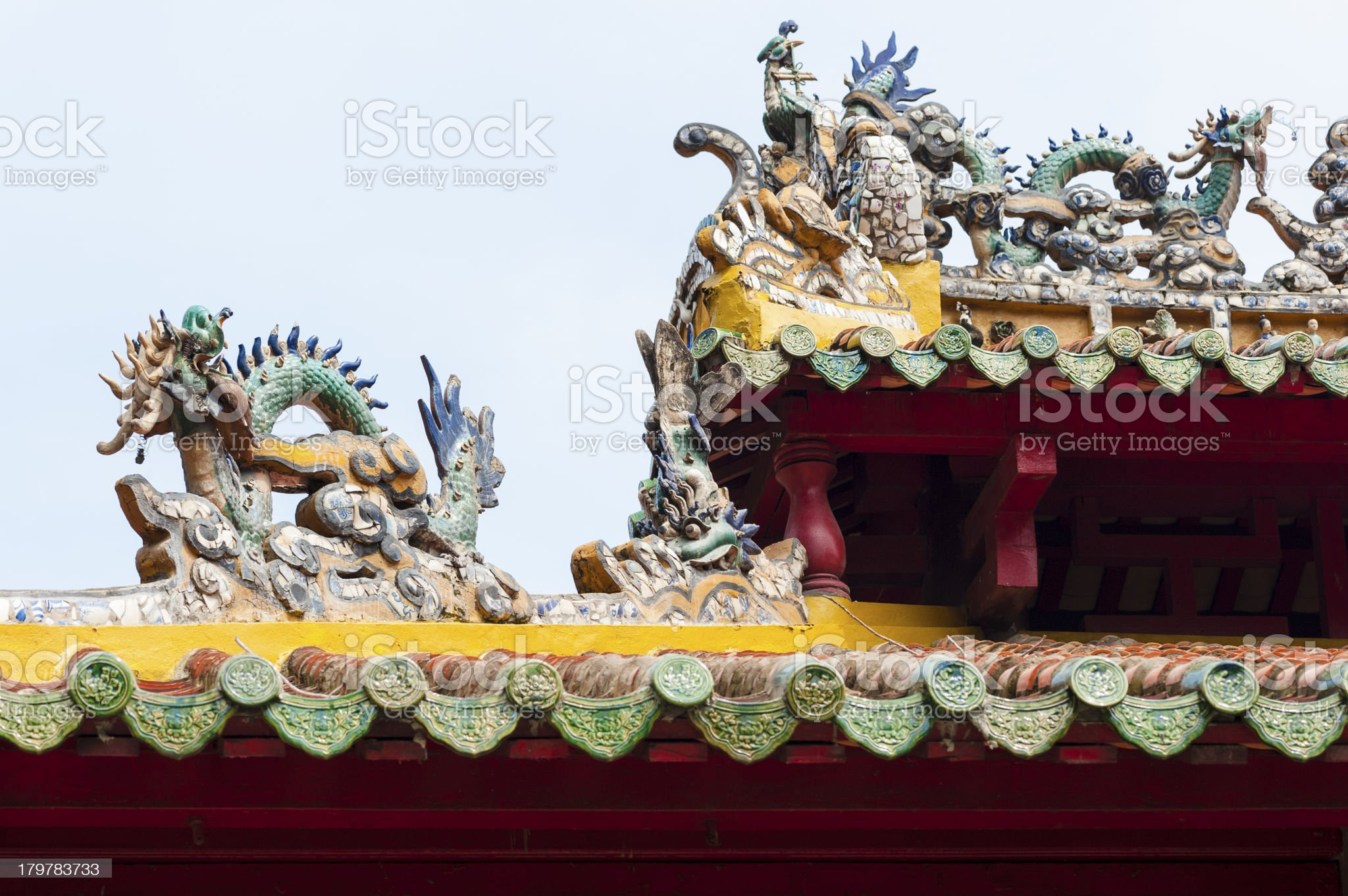Traditional Vietnamese rooftop decorated with sculpture statue and red tiles royalty-free stock photo