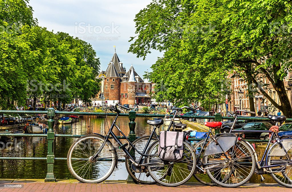Traditional view of Amsterdam: bicycles and water stock photo