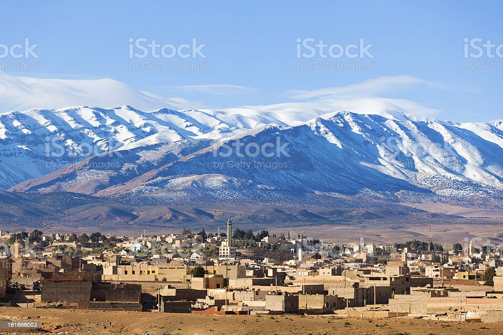 Traditional Village in Morocco under the Mountains stock photo