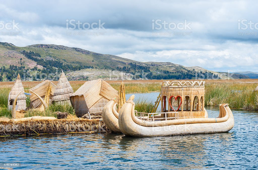 Traditional village on floating islands on lake Titicaca in Peru, stock photo