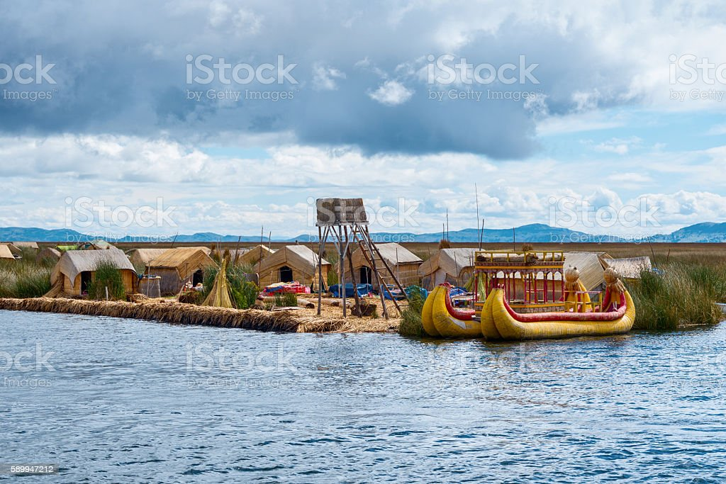 Traditional village on floating islands on lake Titicaca in Peru stock photo