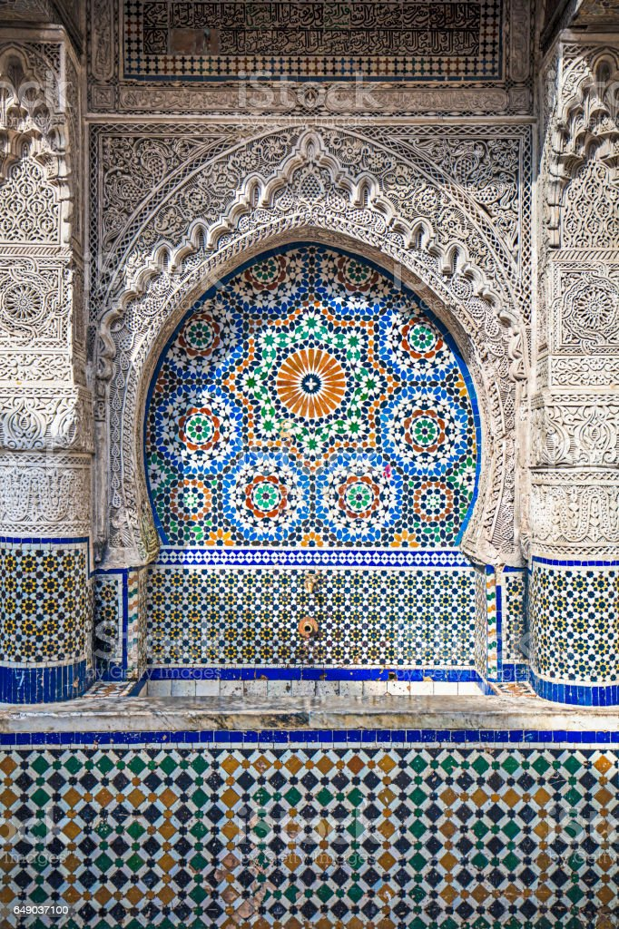 Traditional water fountain in Fez, Morocco stock photo