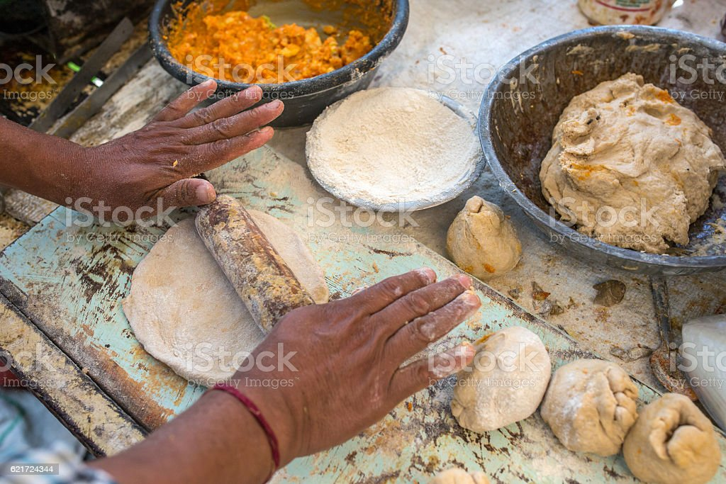 Traditional way of making indian parantha on street sell stall stock photo