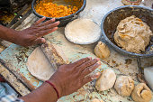 Traditional way of making indian parantha on street sell stall
