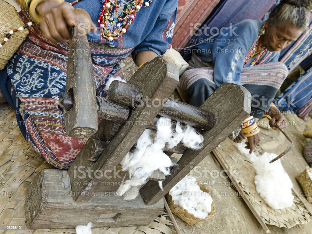 Traditional way of processing cotton stock photo