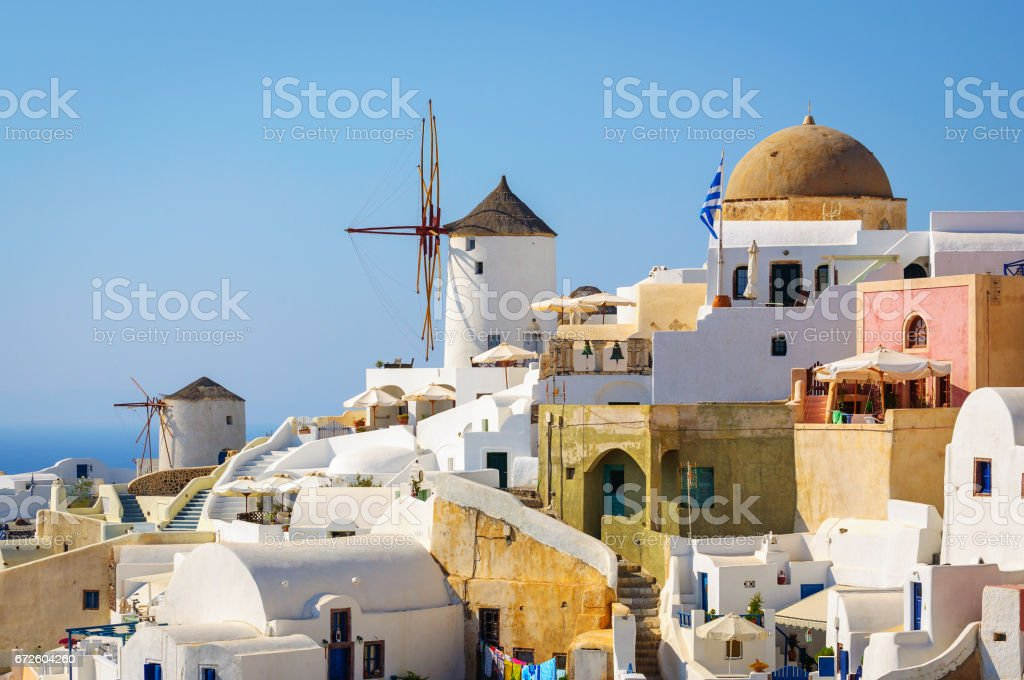 Traditional white architecture with blue churches on Santorini island, Greece stock photo