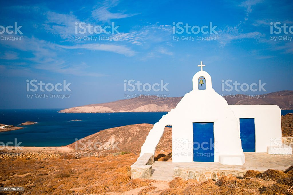 Traditional white church with sea view in Mykonos island,Greece stock photo