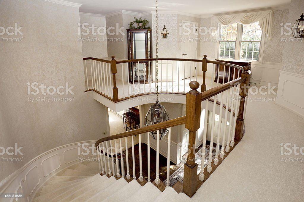 Traditional White Staircase in Two Story Home  Foyer royalty-free stock photo