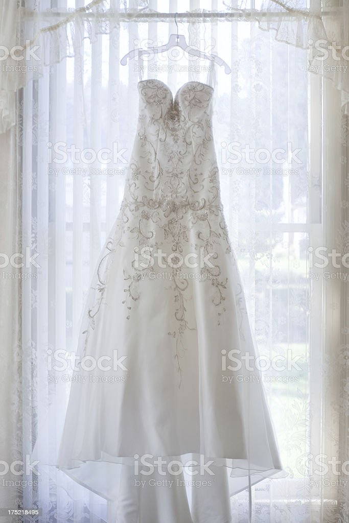 Traditional White Wedding Dress with Embroidery in Window royalty-free stock photo