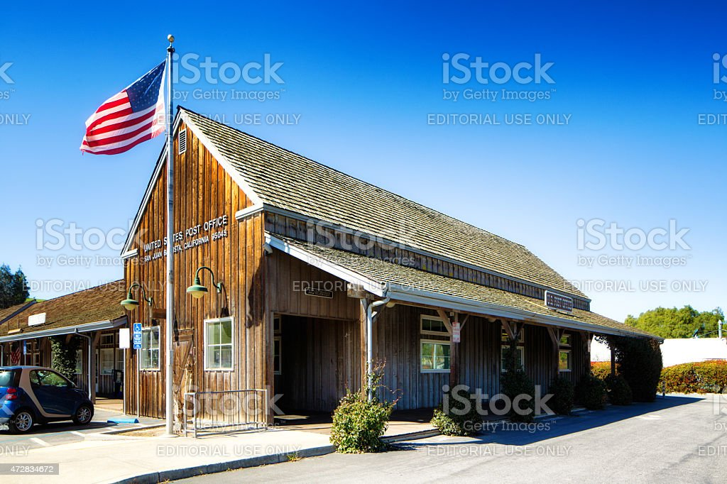 Traditional wild west style American post office with flag stock photo