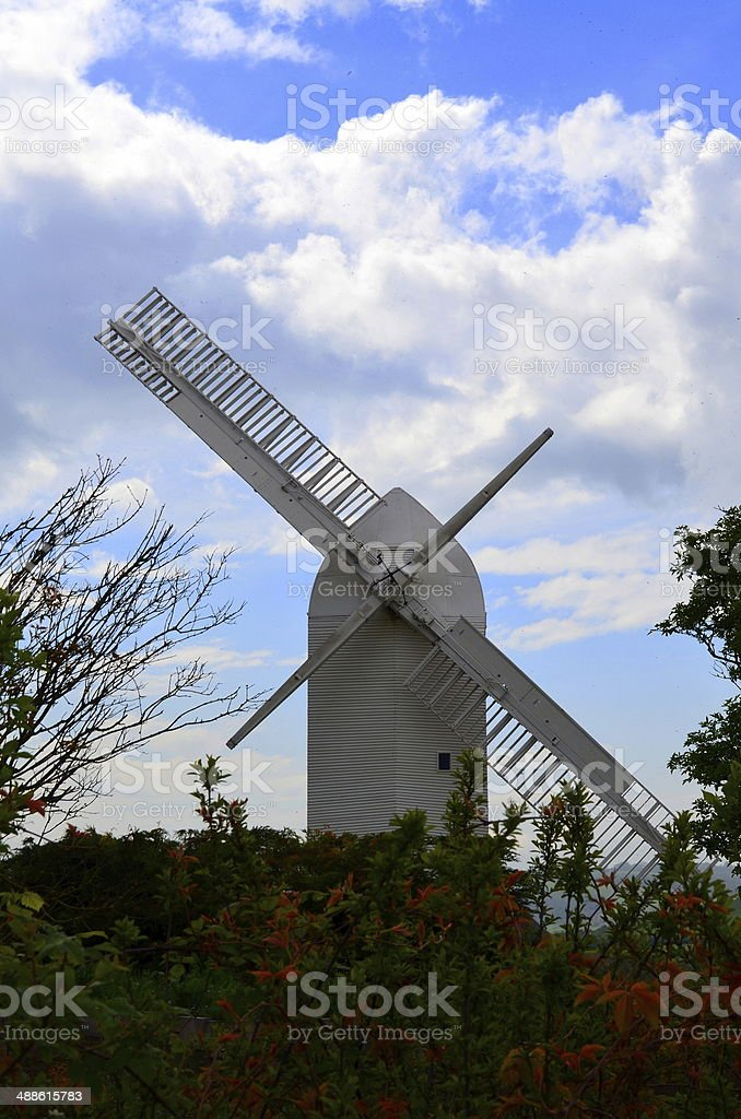 Traditional windmill having sweeps repaired. stock photo
