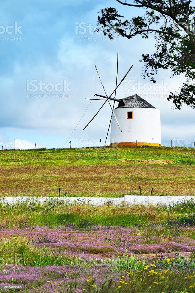 Traditional windmill in the Alentejo region of Portugal stock photo