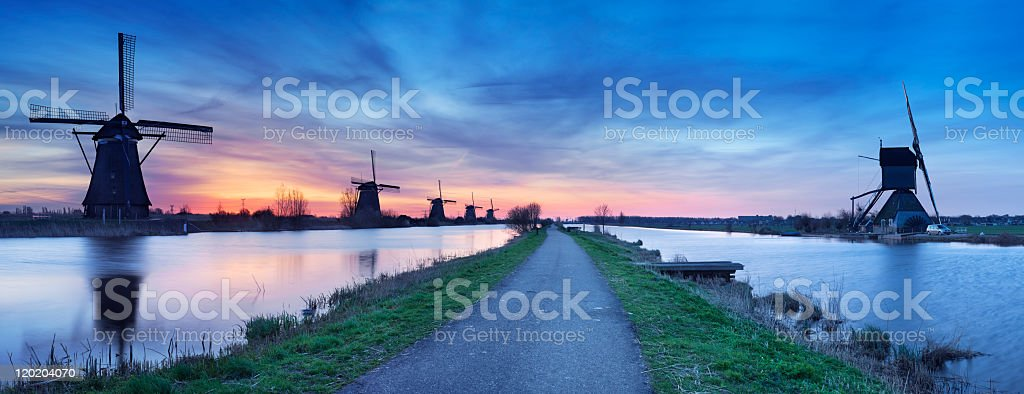 Traditional windmills at sunrise, Kinderdijk, The Netherlands stock photo