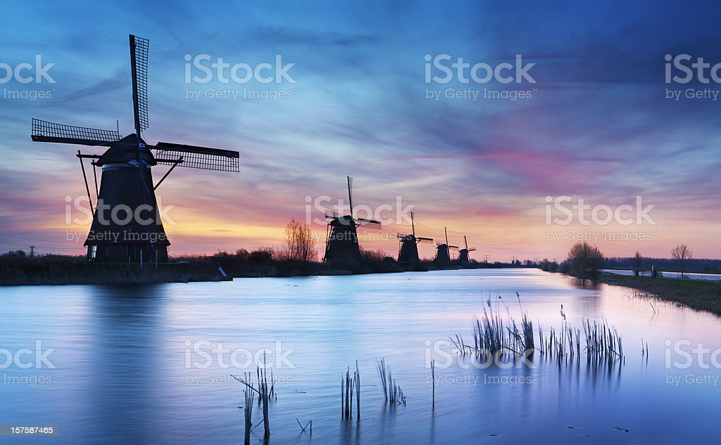 Traditional windmills at sunrise, Kinderdijk, The Netherlands stock photo
