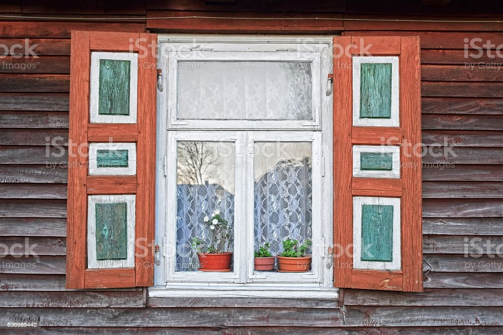 Traditional window in a wooden village house stock photo